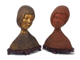 Two female pottery busts, 20th century, of the same model, terracotta, adorned with necklace and