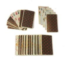 A deck of playing cards, 20th century, in faux-ivory, possibly celluloid, each hand-painted with