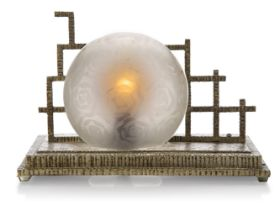 An Art Deco metal table lamp, c.1930, The stepped metal base cast with floral motifs and ribbed