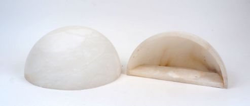 A pair of alabaster wall uplighter shades, 20th Century, of quarter spherical form with hollowed
