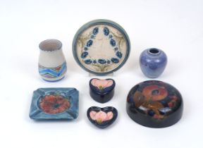 A group of modern decorative pottery, comprising a Moorcroft ash tray, 12cm x 12cm, a Moorcroft