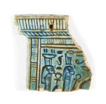 A polychrome glazed composition pylon-shaped pectoral fragment, possibly Egypt New Kingdom, the