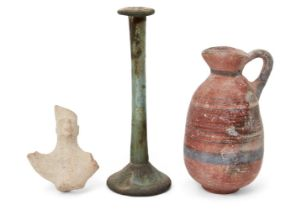 A Cypriot Iron Age black-on-red ware pottery juglet of barrel form with trefoil lip, the