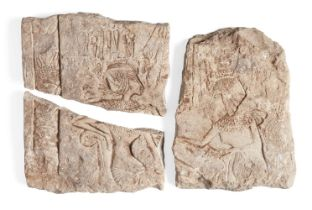 An Egyptian style limestone relief, with Tutankhamun seated on his throne wearing the atef crown and