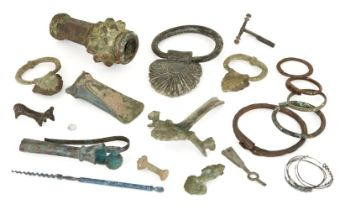 A collection of bronze and iron items, including a macehead, handles, Iron Age and later (18)