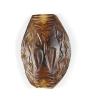 A Western Asiatic banded agate bead, circa 2nd millenium B.C., of elliptical form, carved to one