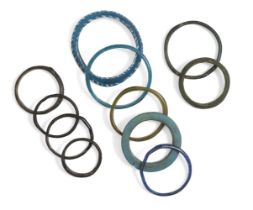 A collection of Roman and Islamic glass bangles, four small bangles of dark blue glass, three