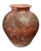 A large Anatolian pottery vessel, circa 2nd Millennium B.C., the rounded vessel tapering to the base