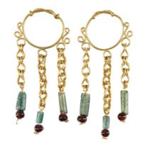 A pair of gold earrings in the Roman style, the hoop with twisted wire detail, each with three