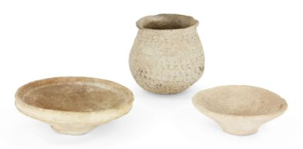 Three Mesopotamian buff coloured coarse ware pottery vessels, including two dishes, one with