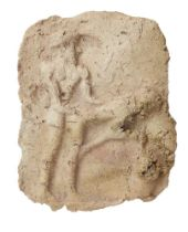 A Mesopotamian baked clay tablet with an erotic scene in high relief, the figure standing behind his