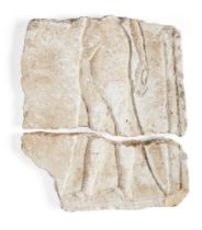 An Egyptian style limestone relief, carved with the profile of an Amarna style princess with