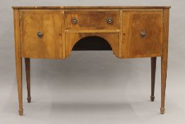 A 19th century style mahogany bow front sideboard. 123 cm wide, 88 cm high, 53.5 cm deep.