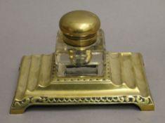 A brass inkwell. 19 cm wide.