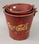 A set of Coke buckets.