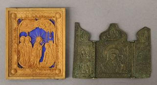 A 19th century Russian carved wooden icon dated 1864 and an 18th century bronze folding icon of