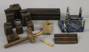 A box of vintage tools and shop weights