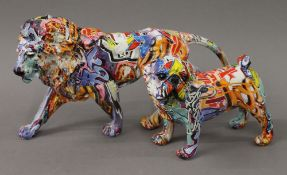 Two graffiti decorated animals. The largest 43 cm long.