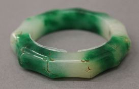 A jade faux bamboo bangle. 8 cm diameter.