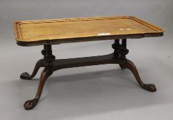 A mahogany coffee table. 94 cm long.
