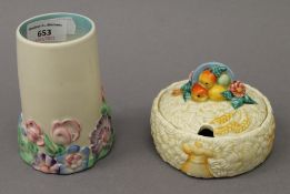 A Clarice Cliff vase and a Clarice Cliff preserve pot. The former 12 cm high.