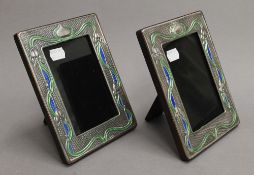 A pair of Art Nouveau style sterling silver photograph frames. Each 14.5 x 19 cm.