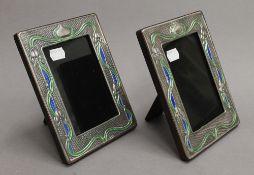 A pair of Art Nouveau style sterling silver photograph frames. Each 14.5 x 19 cm.