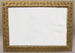 A large late 19th century gilt framed bevelled mirror. 176 x 128 cm.