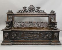 A 19th century carved walnut settle. 180 cm wide.