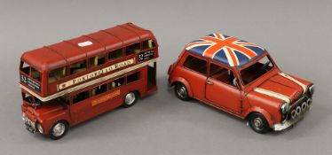 A model of a London bus and a mini. The former 26.5 cm long.