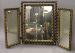 A gilt framed triptych mirror. 58.5 cm high.