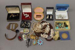 A tin of costume jewellery, etc.