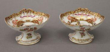 A pair of 19th century German painted porcelain salts. 6 cm high.