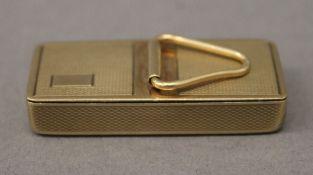 A 9 ct gold pill box. 4.25 cm long. 17.