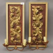 Two carved gilded panels with applied sconces, housed in modern frame. 50.5 cm high.