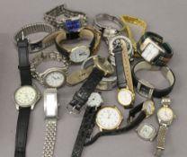 A tin of various wristwatches