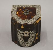 A Victorian silver mounted tortoiseshell tea caddy. 10 cm high.