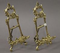 A pair of brass easels. 29.5 cm high.