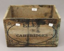 An Eley wooden cartridge box. 35 cm wide.