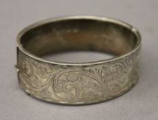 A silver hallmarked engraved bangle. 6.5 cm wide. 29 grammes.