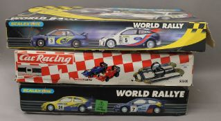 Two large boxed Scalextric and another boxed racing set.