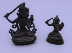 Two small bronze models of buddha. The largest 7.5 cm high.