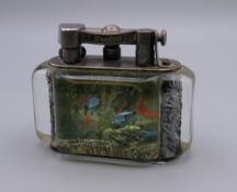 A Dunhill Aquarium table lighter. 9.5 cm wide x 7.5 cm high.