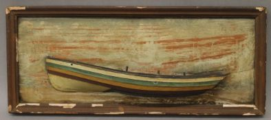 A painted wooden half hull model of a North East Coast fishing boat. 46 cm long.