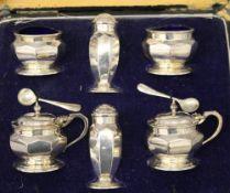 A cased silver cruet set. The case 24.5 cm wide. 8.1 troy ounces.