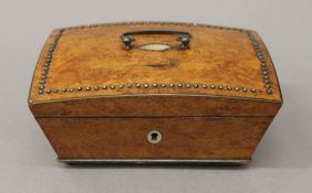 A 19th century Continental burrwood box with steel facet stud decoration. 17 cm wide.