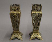 A pair of Victorian pierced brass vases. 21.5 cm high.
