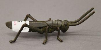 A bronze model of a locust. 11 cm long.