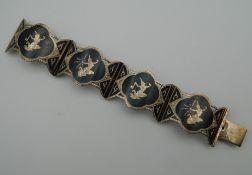 A Siamese silver bracelet. 14 cm long. 44 grammes.