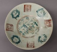A Chinese Celadon dish, possibly Ming. 32.5 cm diameter.